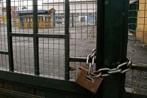 The entrance gates of the Ennio Tardini stadium in Parma are padlocked in February 2015.