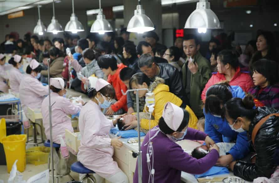 Children receive intravenous transfusion at Xi'an Children's Hospital on December 24, 2013 in Xi an, China. Heavy smog covered many parts of China on Christmas Eve, worsening air pollution.