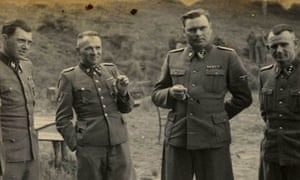 A1944 photo provided by the U.S. Holocaust Memorial Museum (USHMM) shows SS officers socializing on the grounds of the SS retreat, Solahutte outside of Auschwitz, Poland. From left, Dr Josef Mengele - dubbed the Angel of Death, alongside Rudolf Hess, Josef Kramer, and an unidentified officer.