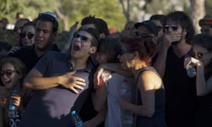 photo, friends of Staff Sgt. Matan Gotlib, a Maglan elite unit soldier, mourn during his funeral in the military cemetery in Rishon Letzion, central Israel.