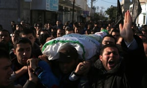 Palestinian mourners carry the body of   Tayseer al-Ismary, a Hamas militant,