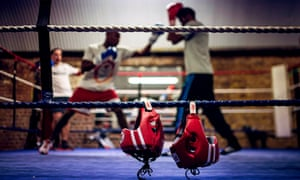 Head guards hang from the ropes as boxers spar at Fitzroy Lodge Boxing Club in Lambeth, London.