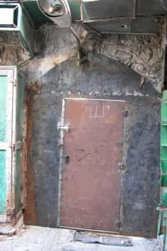 Israeli soldiers bricking up windows and welding shut doors that faced on to streets used by settlers.