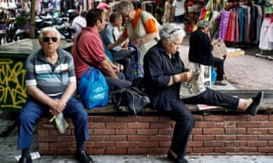 people sit near a market   in Athens
