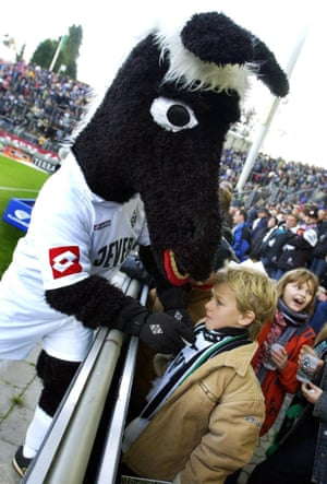 A young fan does his best to ignore Jünter the Foal, Borussia Mönchengladbach's mascot