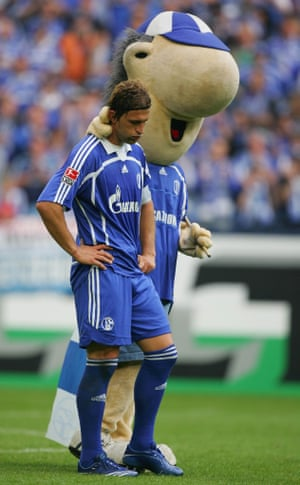 Marcelo Bordon of Schalke fails to see funny side despite the attentions of mascot 'Erwin'