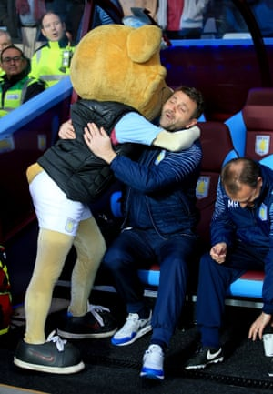 Tim Sherwood is welcomed to Villa Park by mascot Hercules Lion