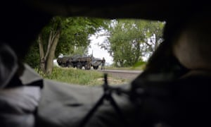 Ukrainian servicemen stand next to an armoured personal carrier after fights with pro-Russian separatists near Avdeevka, Donetsk.