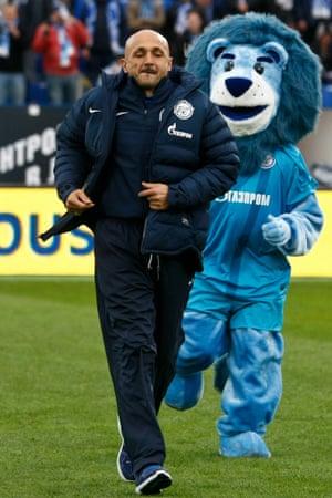 Zenit St. Petersburg head coach Luciano Spalletti is pursued by the Zenit lion