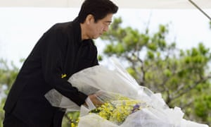 Japanese prime minister Shinzo Abe lays a bouquet of flowers during a memorial service to mark the 70th anniversary of the Battle of Okinawa.