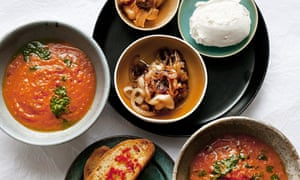 Bowls of roast tomato soup, caramelised onions, chilli toast, goat's curd, basil oil, roasted garlic