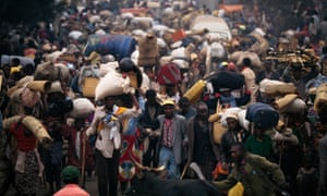 Rwandan refugees in 1994 fleeing to Zaire to escape the genocide.