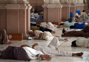 Men rest inside a mosque