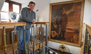 Kevin Wheatcroft at home in Leicestershire, where he keeps one of the largest collections of German military vehicles and Nazi memorabilia.