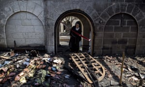 A nun at the Church of Multiplication which was badly damaged in a fire on Thursday.