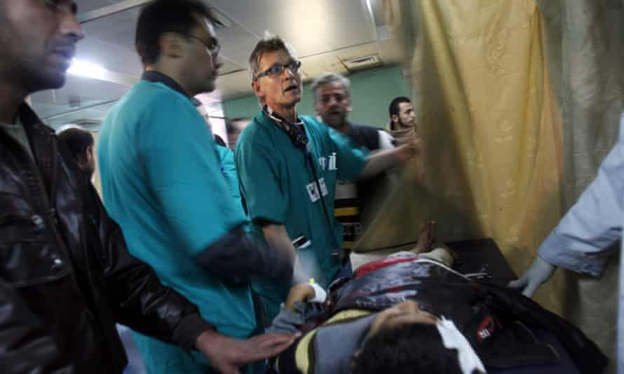 Dr Mads Gilbert treats a patient at Shifa hospital in Gaza