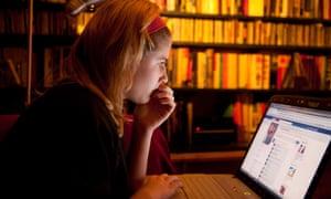 Teenage girl looking at Facebook