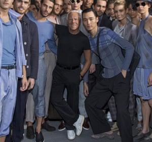 The designer with models at Milan Fashion Week.