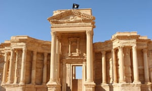 An Islamic State flag flies atop Roman ruins at the ancient city of Palmyra.