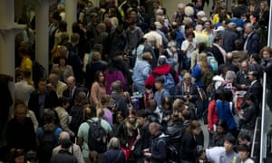 Eurostar passengers wait stranded as Eurostar trains are canceled at St Pancras station in London.