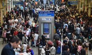 People fill the Eurostar terminal at St Pancras station in London after disruption on the French side of the Channel Tunnel caused all services to be cancelled