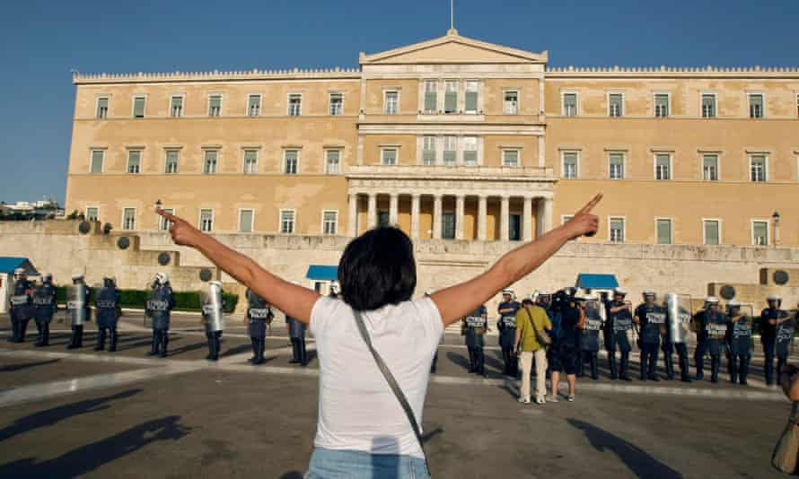 Athenians gather in front of the Greek parliament in protests at politicians' approval of austerity measures.