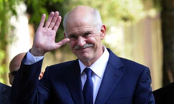Outgoing Greek Prime Minister George Papandreou waves while leaving the Greek Presidential palace in Athens.