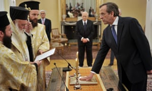 New Democracy party leader Antonis Samaras is sworn in as prime minister during a ceremony at the presidential palace in Athens.