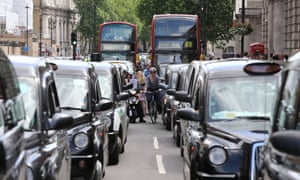 black cabs in London traffic