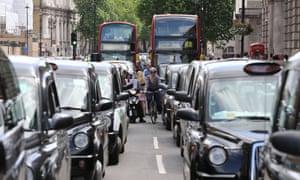 black cabs in London traffic