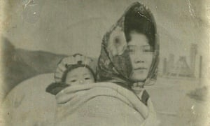 Hyeonseo Lee's mother carries her, aged three, on her back