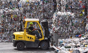 A forklift operator stacks bales of recyclables at Waste Management's facility in Elkridge, Md.