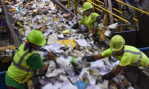 Workers sort waste at the Waste Management's Elkridge Material Recycling Facility