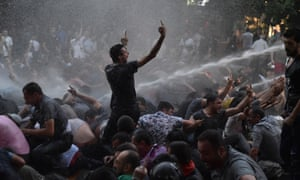 A protestor's defiance in the face of water cannon – an image which has been widely shared on social media