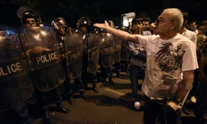 Demonstrators speak to police as they block the streets during a night of clashes. The gathered protestors have refused to meet with president Serzh Sarkisian, preferring to continue with the sit-in