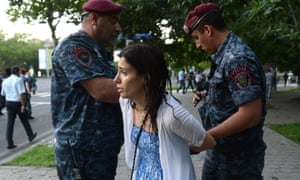 A woman is arrested in Yerevan. Protests have now reportedly spread to the city of Gyumri in the north-west of Armenia, where a further 12 were arrested on Tuesday