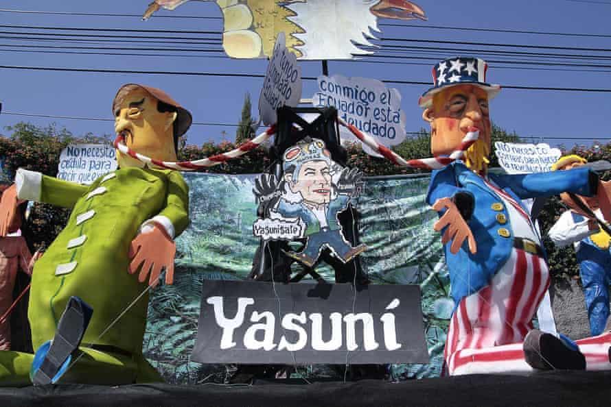 Dolls representing the oil exploitation in the Yasuni zone are paraded in Quito