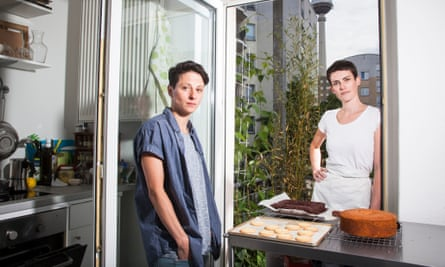 Ruth and her partner with cakes she has baked in the kitchen of their flat in Berlin