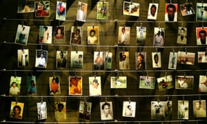 The pictures of people killed in the 1994 genocide donated by survivors are installed on a wall inside the Gisozi memorial in Rwanda's capital, Kigali.