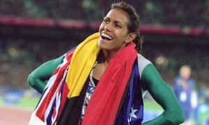 25 Sep 2000:  Cathy Freeman of Australia is elated after winning Gold in the 400m Final during the 2000 Sydney Olympic Games at Stadium Australia in Sydney, Australia. Mandatory Credit: Nick Wilson/ALLSPORTOLYW400M