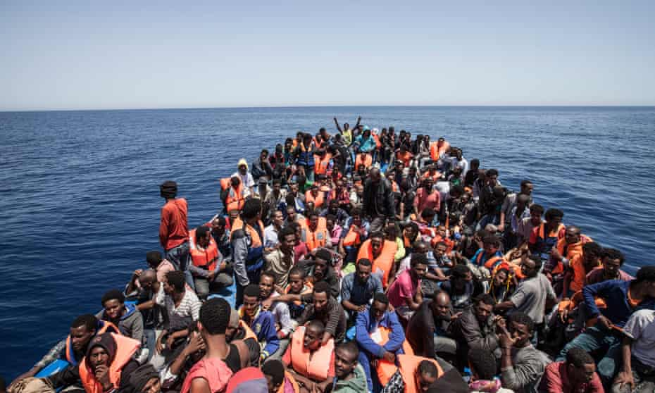Hundreds of migrants on a ship in the Mediterranean off the coast of Libya, encountered by the privately funded rescue foundation Moas.