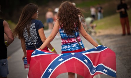 Two young women with a confederate flag.