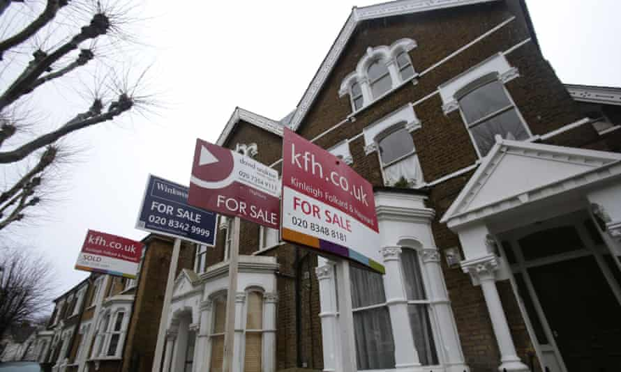 For Sale signs displayed outside houses in Finsbury Park, north London