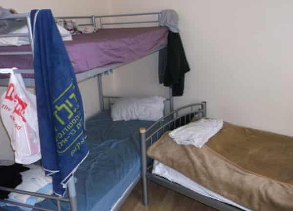 A first floor front bedroom containing one bunk bed and three single beds