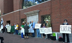 Demonstrators against the death penalty stand outside the US District Court in Boston as Dzhokhar Tsarnaev awaits his official sentence of death on 24 June  2015.