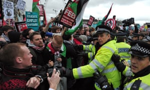 Protesters scuffle with police during a student rally in central London, in 2012, against rises in university tuition fees.