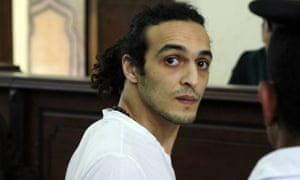 Mahmoud Abou-Zeid, an Egyptian photojournalist known by his nickname Shawkan, appears before a judge in May for the first time after spending more than 600 days in prison in Cairo.