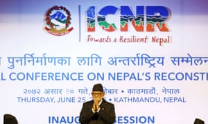 The Nepalese prime minister Sushil Koirala greets donors at the international conference on Nepal's reconstruction in Kathmandu.