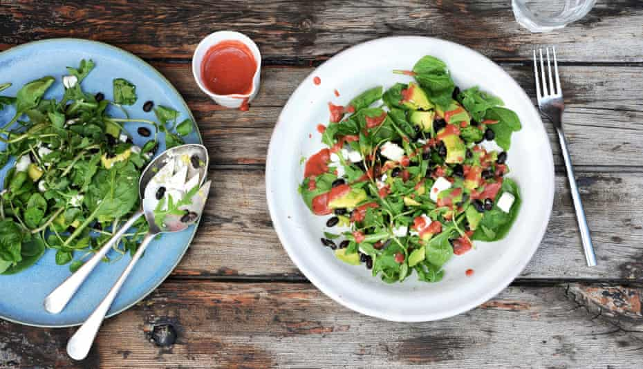 Raspberry dressing spruces up a mixed salad of avocado and rocket