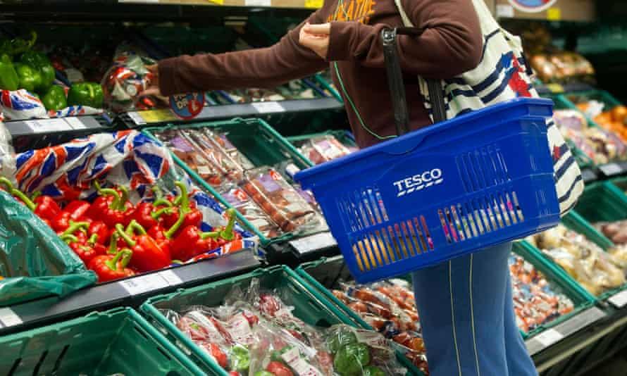 shopper in tesco with basket